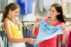 image of surprised girl looking at blue tanktop - stock photo