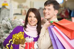 Portrait of joyful husband and wife going shopping before christmas Stock Photos
