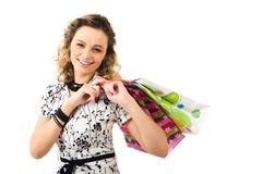 photo of pretty girl holding paper bags and looking at camera over white backgro - stock photo
