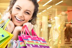 Close-up of cheerful woman's face on the background of shop window Stock Photos