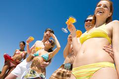 image of five happy teens during summer holiday - stock photo