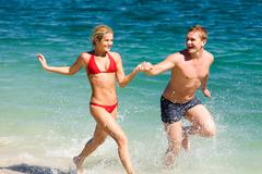 Portrait of happy people running together while summer vacation Stock Photos
