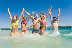 image of happy teens playing while their vacation - stock photo
