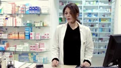 Pharmacist taking medicines for customer Stock Footage