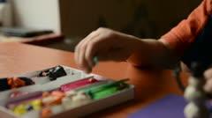 Child hands models plasticine. Dolly shot Stock Footage