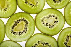 close-up of several parts of kiwi on a white background - stock photo