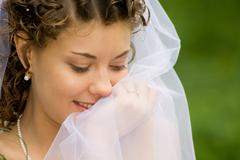 Portrait of beautiful woman with chiffon veil in a natural environment Stock Photos