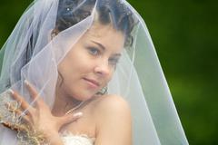 image of head of attractive woman under white veil - stock photo