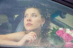 view of beautiful woman sitting in the car driving her to wedding - stock photo