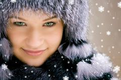 Image of beautiful female in luxurious fur head cloth looking at camera Stock Photos