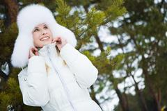 Photo of lovely woman walking out in forest on winter day Stock Photos