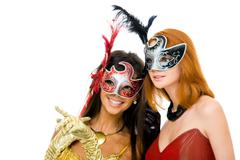 Portrait of glamorous girls looking through venetian masks during carnival Stock Photos