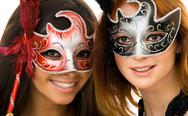Stock Photo of portrait of two smart ladies in masks at masquerade