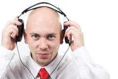 Portrait of handsome male preparing for listening to music through headphones Stock Photos