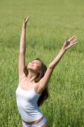 portrait of beautiful woman in underwear raising hands outdoor - stock photo