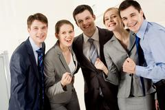 portrait of happy business partners looking at camera and showing sign meaning t - stock photo