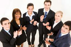 Above shot of happy business partners applauding and looking at camera Stock Photos
