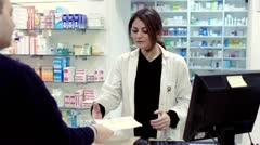 Stock Video Footage of Pharmacist taking medicines for customer