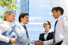 Photo of successful associates handshaking after striking deal outdoors at meeti Stock Photos