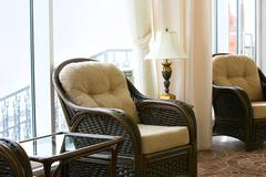 Photo of elegant arm chair in modern room or workshop Stock Photos