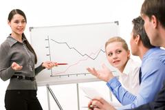 Image of confident woman making presentation and interacting with the audience Stock Photos