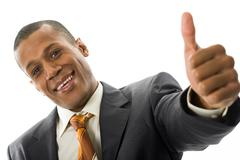 Happy businessman showing his thumb up with smile over white background Stock Photos