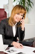 portrait of lovely business lady calling by the phone in office and looking at c - stock photo