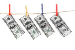 Image of american dollars hanging on rope and drying Stock Photos