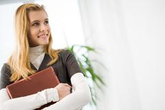 Photo of charming female student looking aside while in classroom Stock Photos