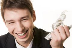 Photo of laughing male with crumpled dollar banknote in hand over white backgrou Stock Photos