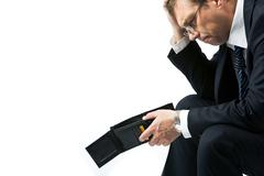 Image of sad businessman holding empty wallet and grieving Stock Photos