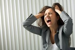 Photo of depressed female screaming in desperation Stock Photos