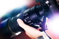 Taking pictures - telephoto lens with image stabilization system - stock photo