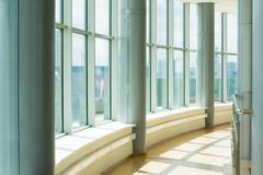 Image of corridor in office building with big windows passing daylight Stock Photos
