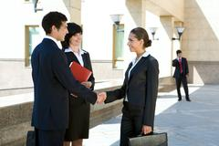 photo of successful people making an agreement - stock photo