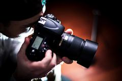 The photographer. Paparazzi photographer with dslr camera - stock photo
