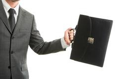 close-up of businessman with briefcase in hand isolated on white background - stock photo