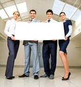 portrait of business people promoting something - stock photo
