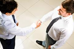 Above view of two businessmen handshaking Stock Photos