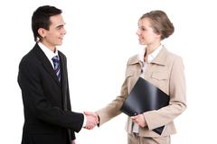 Portrait of successful business partners shaking hands after striking a deal Stock Photos