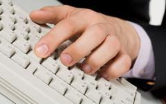 image of human fingers on keyboard buttons during computer work - stock photo