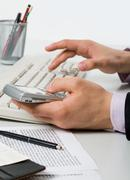 Close-up of male hand pressing keys of smartphone and pushing buttons of keypad Stock Photos