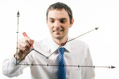 photo of graph being drawn by happy professional at during presentation - stock photo
