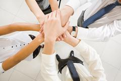 image of business people hands on top of each other symbolizing support and powe - stock photo