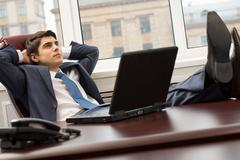 Portrait of smart businessman thinking about something on workplace Stock Photos