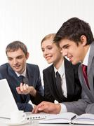 portrait of executive employees planning work and looking at laptop monitor duri - stock photo