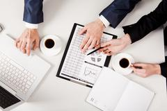 above view of business people hands working with documents at workplace - stock photo