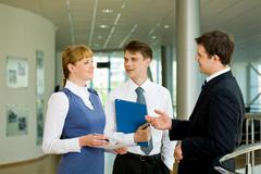 Photo of confident businessteam planning work or consulting each other Stock Photos