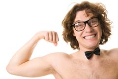 portrait of man with bowtie showing his strength - stock photo