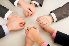 Image of business partners hands holding each other Stock Photos